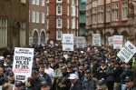 Police officers and public sector workers march through central London