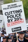 Police officers march through central London